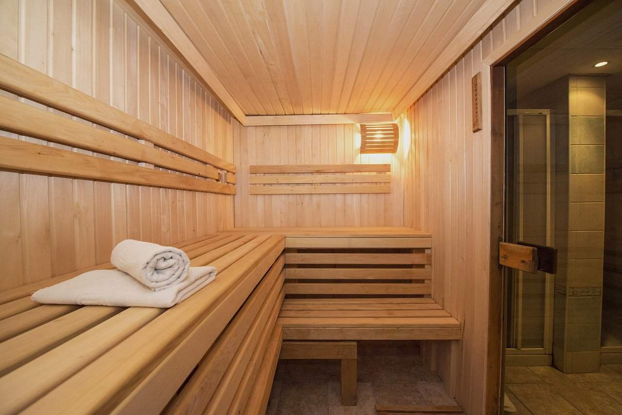 A infrared sauna with a white towl