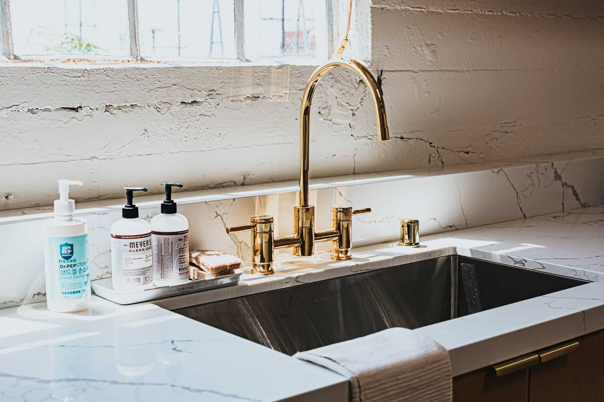 Stainless steel sink and faucet in a farmhouse kitchen