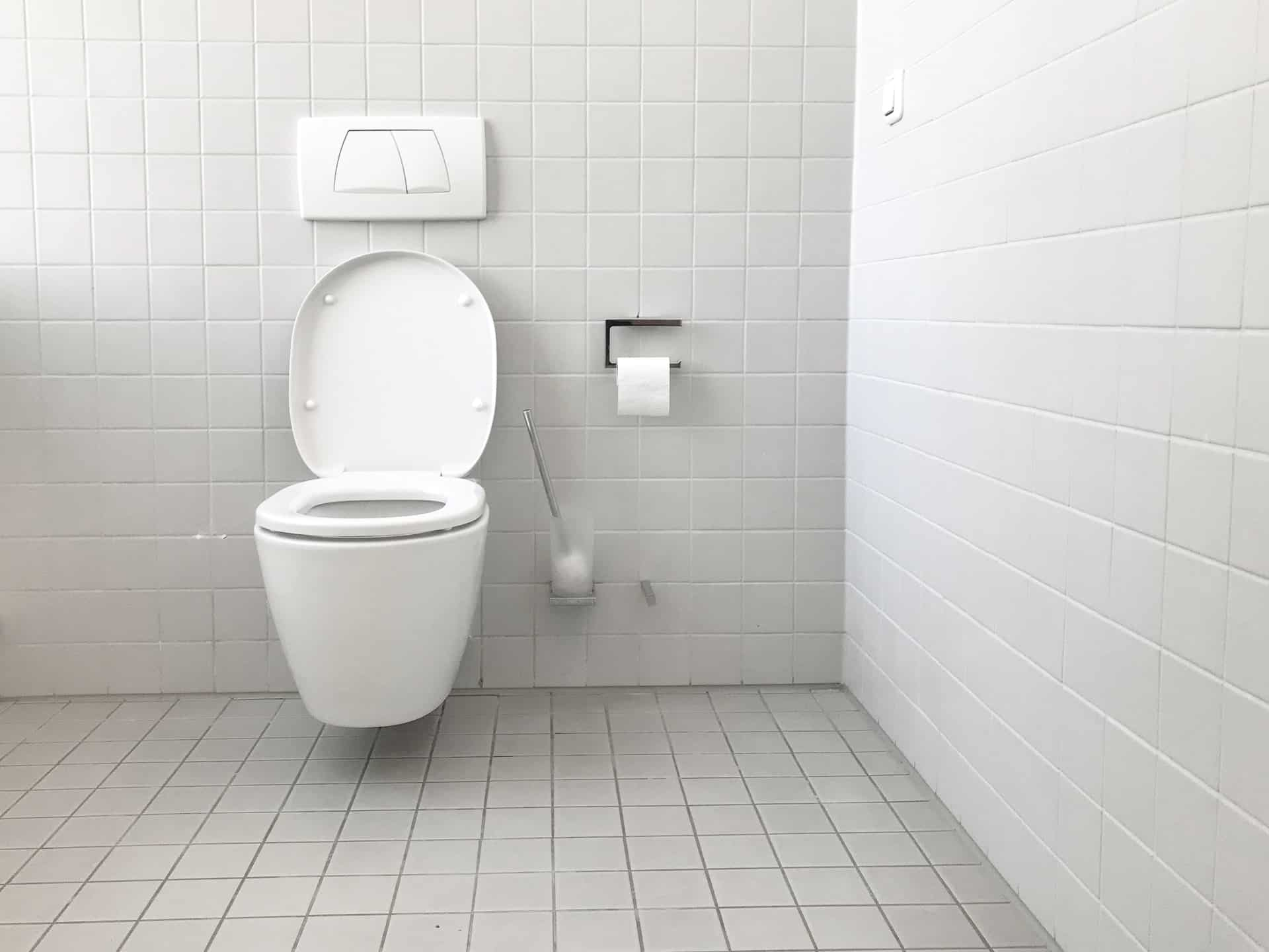 A standard height toilet in a tiled bathroom