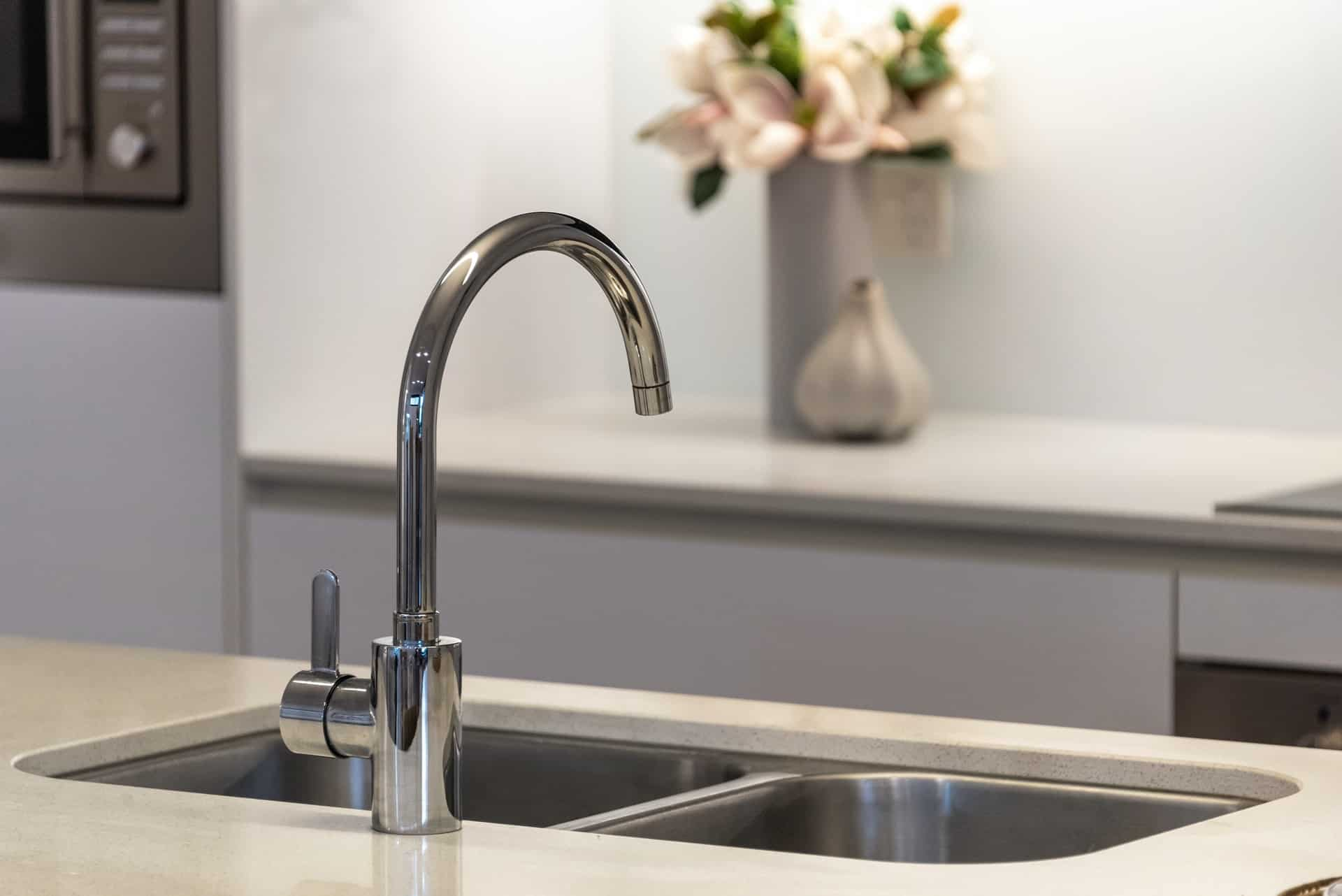 Pfister faucet in a modern white kitchen