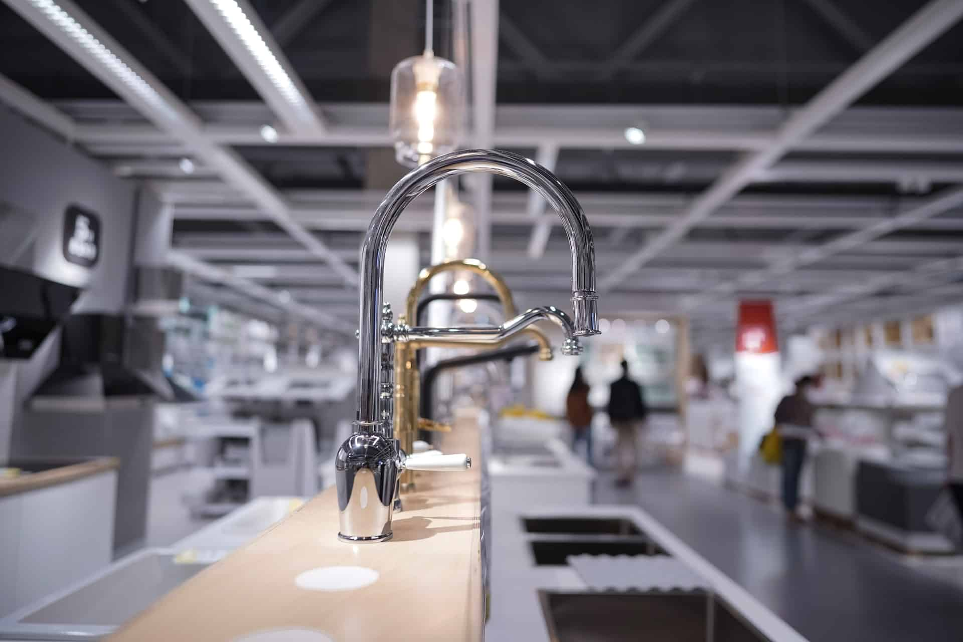 Four types of affordable kitchen faucets in a warehouse
