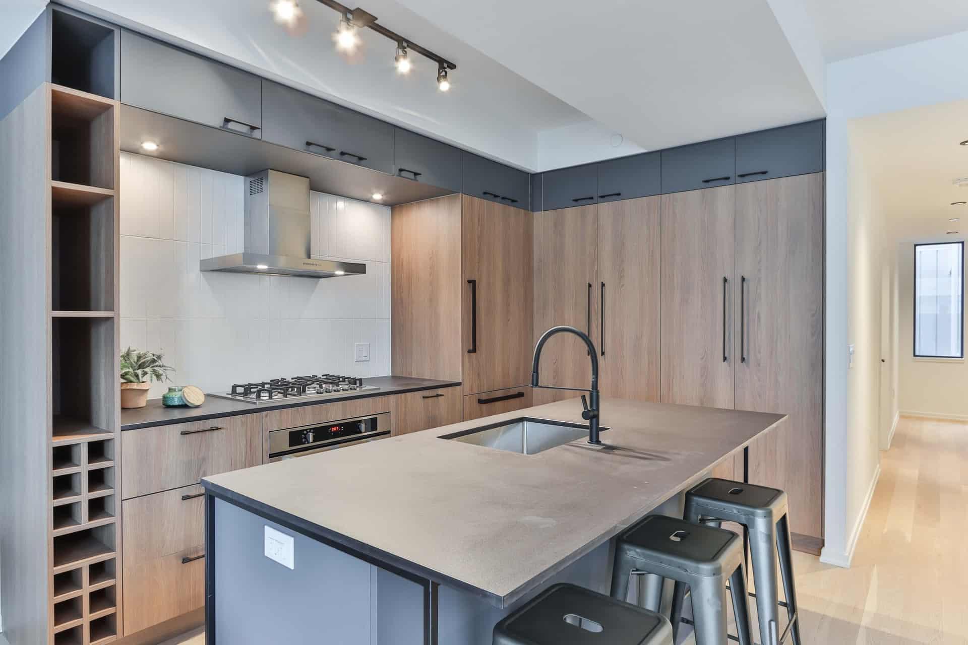 kohler kitchen faucet in a modern wood-style kitchen